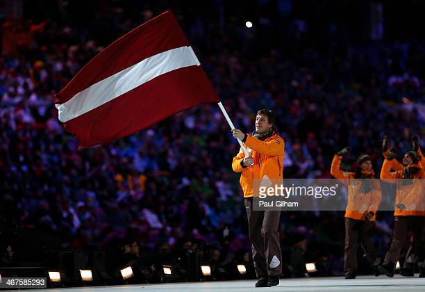 Ice hockey player Sandis Ozolins of the Latvia Olympic team carries his country's flag during the Opening Ceremony of the Sochi 2014 Winter Olympics...