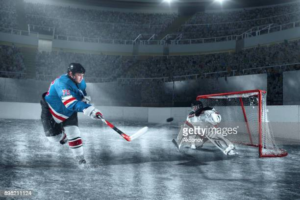 ice hockey player scores a goal on big professional ice arena - hockey player stock pictures, royalty-free photos & images