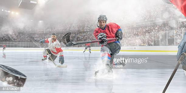 ice hockey player scoring - ice hockey stock pictures, royalty-free photos & images