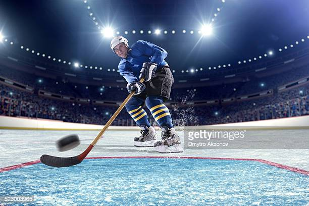 ice hockey player scoring - hockey stock pictures, royalty-free photos & images