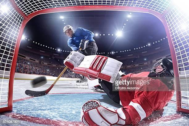 アイスホッケー選手スコア - アイスホッケースティック ストックフォトと画像