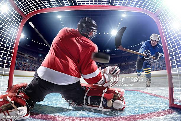 ice hockey player scoring - hockey player stock pictures, royalty-free photos & images