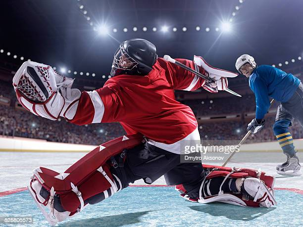 ice hockey player scoring - ice hockey player stock pictures, royalty-free photos & images