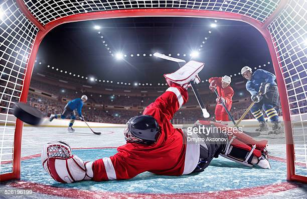 ice hockey player scoring - ice hockey stick stock pictures, royalty-free photos & images