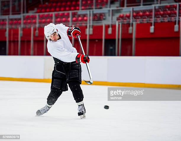 Ice Hockey Player Shooting at Goal