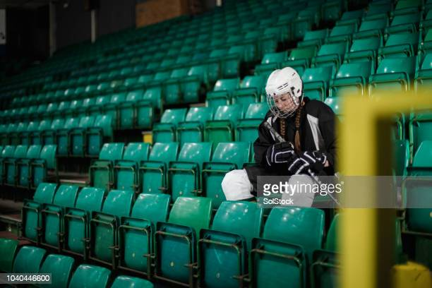 ice hockey player sitting alone - sports training drill stock pictures, royalty-free photos & images