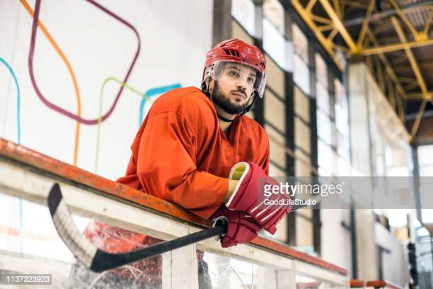 ice hockey player waiting for his chance - ice hockey rink stock pictures, royalty-free photos & images