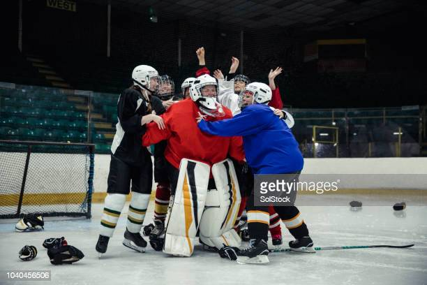 ice hockey players celebrating - human limb stock pictures, royalty-free photos & images