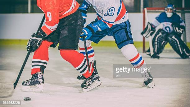 ice hockey players duel - ice hockey player stock pictures, royalty-free photos & images