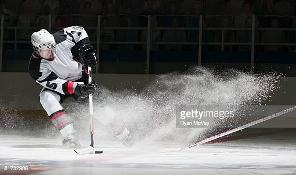 Ice hockey players facing off