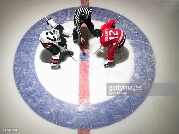 Ice hockey players facing off