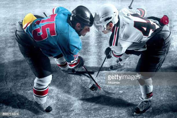 ice hockey players from opposing teams face to face - face off stock pictures, royalty-free photos & images
