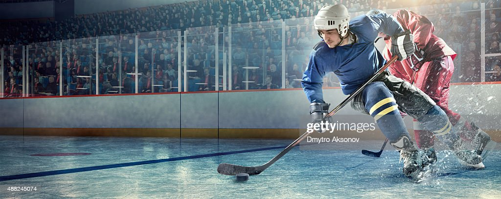 Ice hockey players in action : Stock Photo