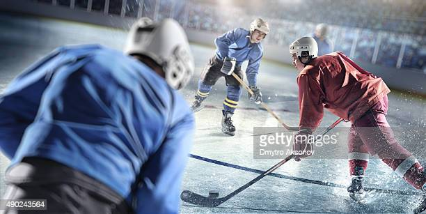 ice hockey players in action - ice hockey player stock pictures, royalty-free photos & images