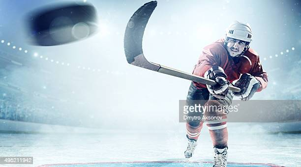 ice hockey players in action - ice hockey stock pictures, royalty-free photos & images