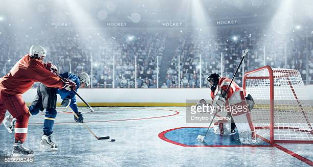 ice hockey players in action - hockey stock pictures, royalty-free photos & images