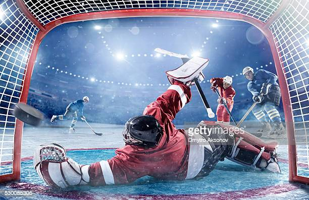 ice hockey players in action - hockey player stock pictures, royalty-free photos & images
