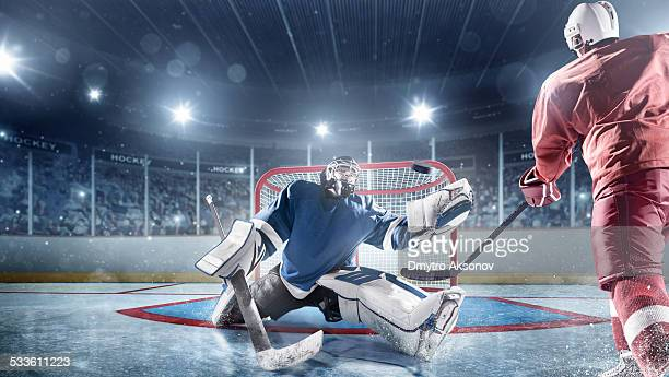 ice hockey players in action - goalkeeper stock pictures, royalty-free photos & images