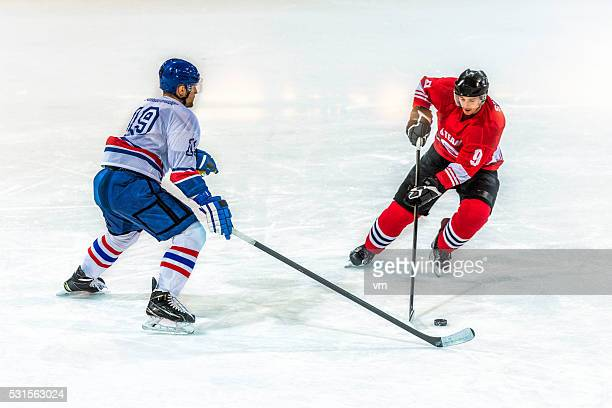 ice hockey players - face off sports play stock photos and pictures