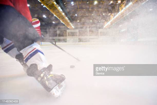 ice hockey players playing ice hockey - ice hockey player stock pictures, royalty-free photos & images