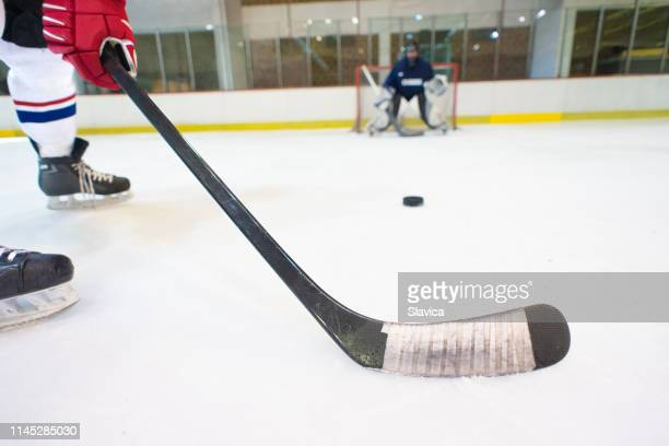 ice hockey players playing ice hockey - hockey stick stock pictures, royalty-free photos & images