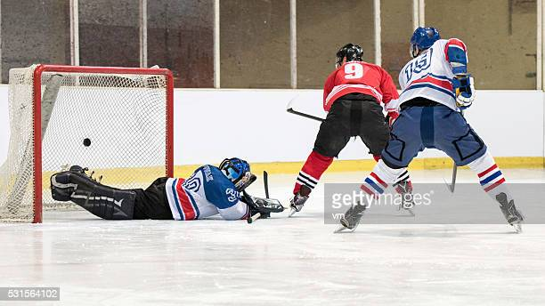 Ice hockey players scoring goal