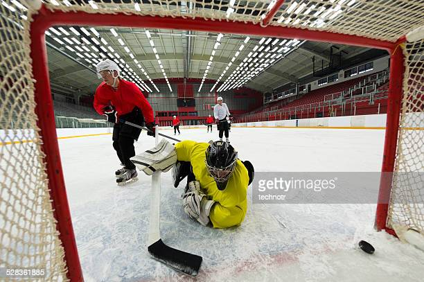 ice hockey players scoring the goal - ice hockey glove stock pictures, royalty-free photos & images