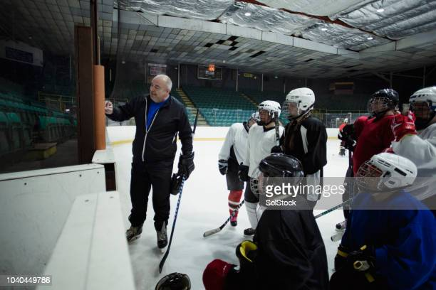 ice hockey practice session - hockey stock pictures, royalty-free photos & images