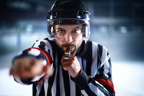 Ice hockey referee. 481538109