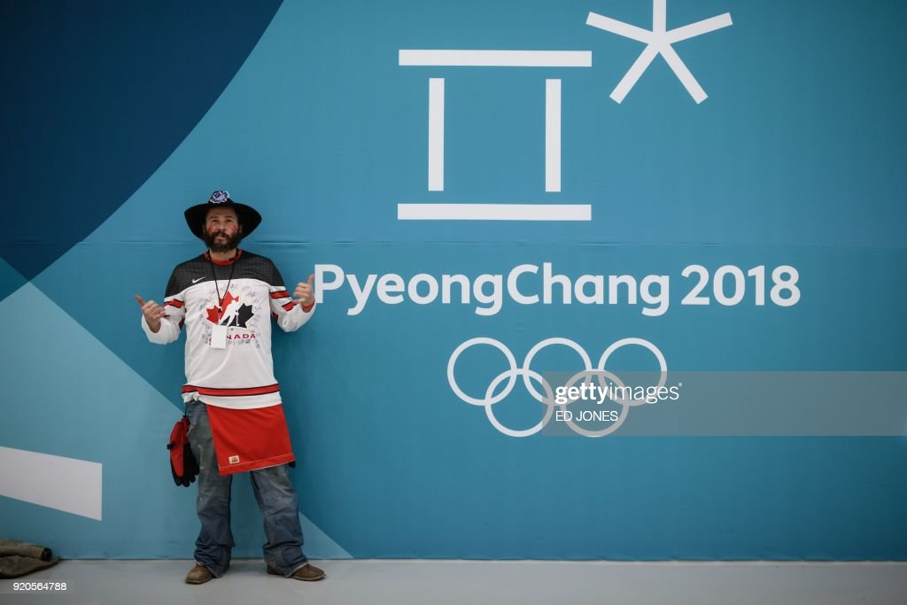 Ice hockey spectator Darcy Howat of Canada poses for a portrait at the Gangneung Ice Arena ice hockey venue of the Pyeongchang Winter Olympic games, in Gangneung on February 19, 2018. / AFP PHOTO / Ed JONES