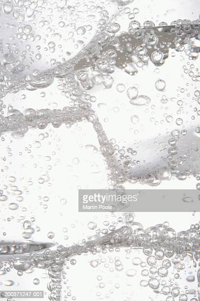 ice in carbonated water - carbonated water stock pictures, royalty-free photos & images