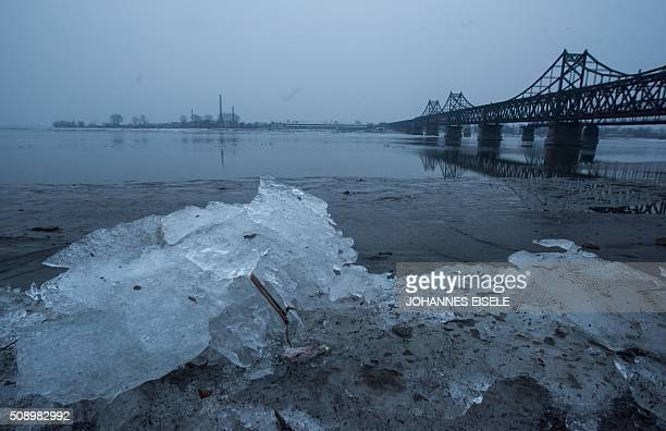 Ice is pictured on the banks of the Yalu River in the Chinese border town of Dandong opposite to the North Korean town of Sinuiju on February 8 2016...