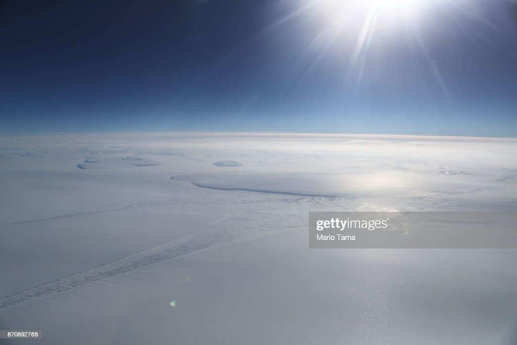 Ice is seen from NASA's Operation IceBridge research aircraft in the Antarctic Peninsula region, on November 4, 2017, above Antarctica. NASA's Operation IceBridge has been studying how polar ice has evolved over the past nine years and is currently flying a set of nine-hour research flights over West Antarctica to monitor ice loss aboard a retrofitted 1966 Lockheed P-3 aircraft. According to NASA, the current mission targets 'sea ice in the Bellingshausen and Weddell seas and glaciers in the Antarctic Peninsula and along the English and Bryan Coasts.' Researchers have used the IceBridge data to observe that the West Antarctic Ice Sheet may be in a state of irreversible decline directly contributing to rising sea levels. The National Climate Assessment, a study produced every 4 years by scientists from 13 federal agencies of the U.S. government, released a stark report November 2 stating that global temperature rise over the past 115 years has been primarily caused by 'human activities, especially emissions of greenhouse gases'.