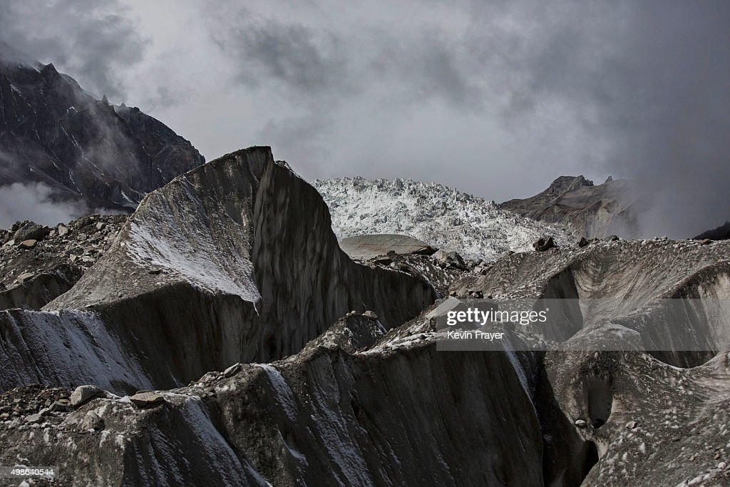 Ice is seen in the Large Ice Fall, top, of Glacier 1, at the base of the 7,556 m (24,790 ft) Mount Gongga, known in Tibetan as Minya Konka, on November 12, 2015 in Hailuogou, Garze Tibetan Autonomous Prefecture, Sichuan province, China. Hailuogou is one of China's 8,500 monsoonal glaciers and the longest of 71 glaciers on the eastern slope of Mt. Gongga. Monsoonal glaciers are found at lower altitudes and are at much higher risk to the effects of rising temperatures and climate change. Chinese scientists studying the impact on the Tibetan plateau warn the ablation rate of monsoonal glaciers is alarming. Data shows the Hailuogou basin glaciers have lost nearly 3 kilometers of mass since the 1960s and the rate is accelerating. Some researchers are concerned the glaciers could shrink at an accelerated rate beyond the present 20 meters a year and thin at a rate of more than 1 meter per year. At an upcoming conference in Paris, the governments of 196 countries will meet to set targets on reducing carbon emissions in an attempt to forge a new global agreement on climate change.
