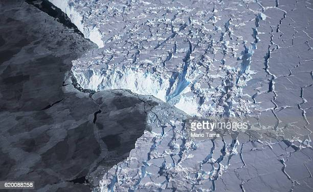 Ice is viewed near the coast of West Antarctica from a window of a NASA Operation IceBridge airplane on October 28 2016 inflight over Antarctica...