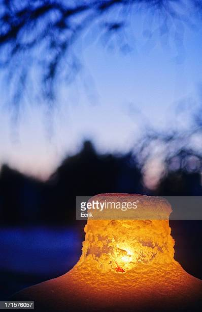 Ice lantern in snow