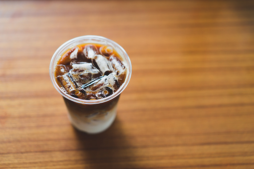 Ice latte coffee cup on wooden table.Cafe culture photography concept. - gettyimageskorea