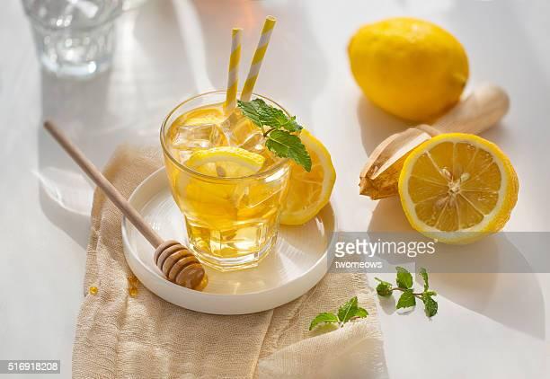 Ice lemonade on white table top background.