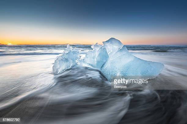 Ice on ice beach with water wave in Jokulsarlon, Iceland.