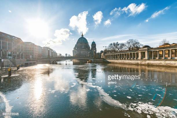 ice on river with berlin cathedral - berlin stock pictures, royalty-free photos & images