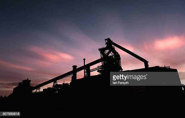 Ice particle iridescence can be seen in highlevel Nacreous clouds above the former SSI Steel blast furnace on February 2 2016 in Redcar England The...
