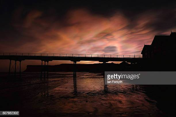 Ice particle iridescence is seen in highlevel Nacreous clouds visible over the pier on February 02 2016 in SaltburnbytheSea England The rare effect...