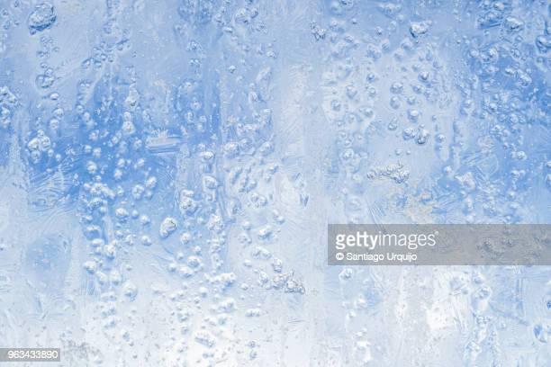 ice patterns on a window - winter weather stock photos and pictures