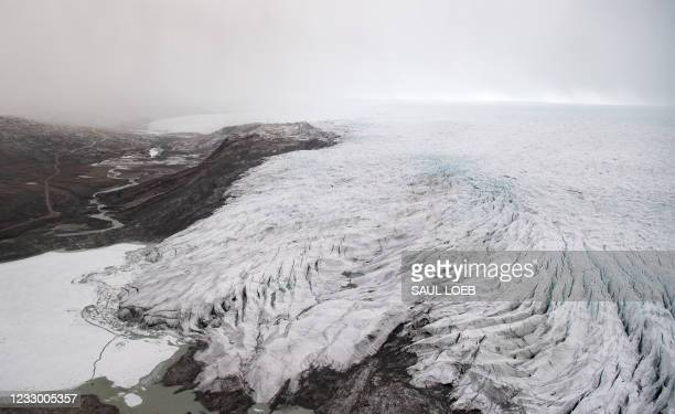 Ice recedes from a glacier as seen from an aerial helicopter tour with US Secretary of State Antony Blinken of ice caps and fjords near...