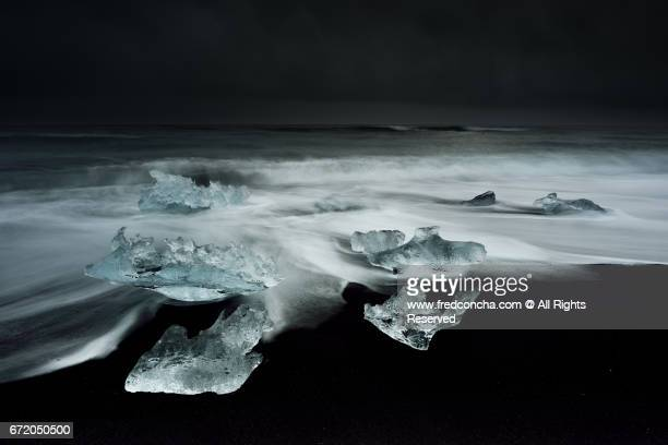 Ice rests on the beach off the inlet to Jokulsarlon Glacial Lagoon in southwest Iceland.