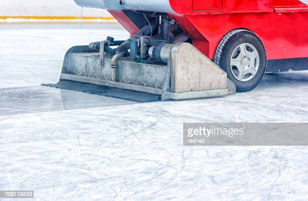 Ice resurfacer driving across on an ice rink