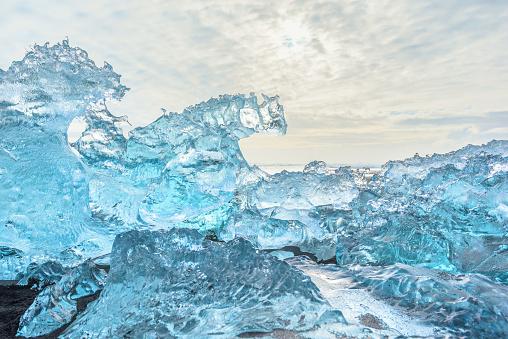 Ice rock with black sand beach at Jokulsarlon beach (Diamond beach) in southeast Iceland. - gettyimageskorea