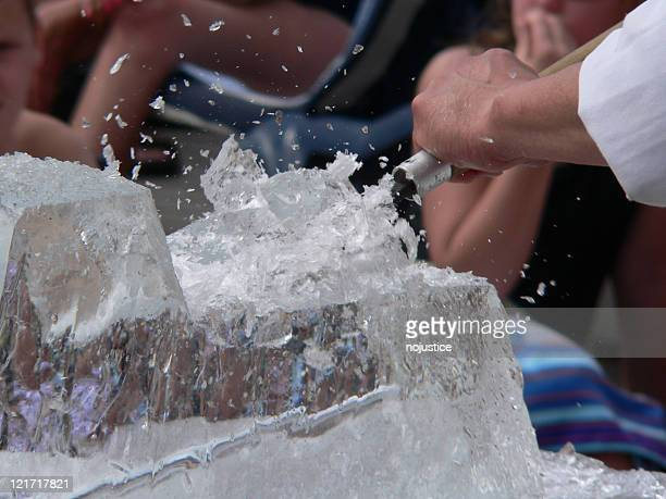 ice sculptor chiseling a creation from a block of ice - carving craft product stock pictures, royalty-free photos & images