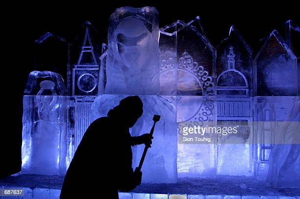 Ice Sculptor Duncan Hamilton puts the finishing touches to an ice sculpture portraying the London skyline December 14 2001 in front of the Millennium...