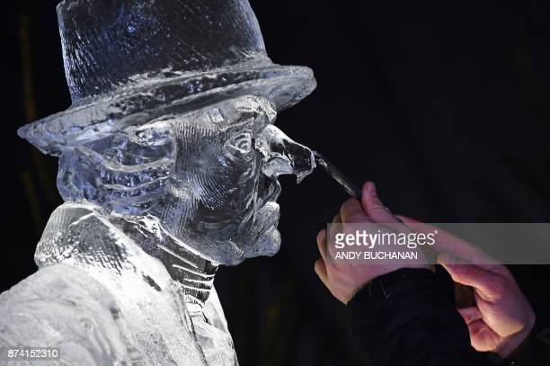 Ice sculptor Jack Hackney puts the finishing touches to an ice sculpture which makes up part of a forthcoming exhibition 'The Ice Adventure A Journey...